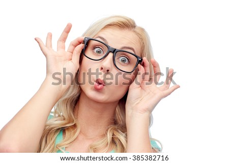 vision, education and people concept - happy young woman or teenage girl glasses making funny fish face - stock photo