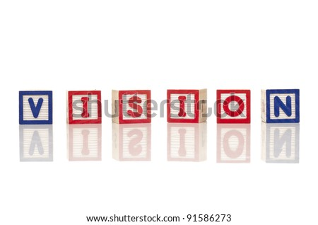 vision word at wood blocks isolated on white background - stock photo