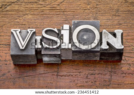 vision word in mixed letterpress metal type printing blocks over grunge weathered wood - stock photo