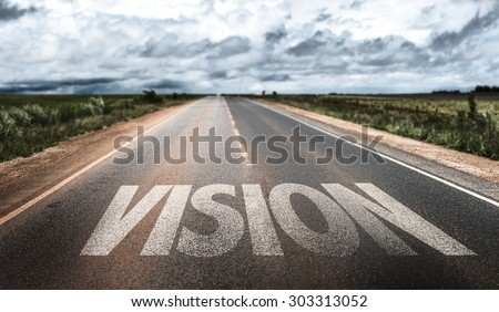 Vision written on road - stock photo