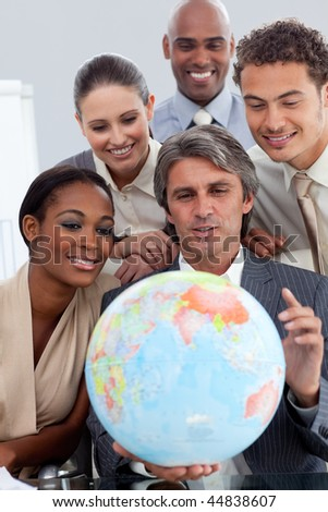 Visionary business people smiling at global business expansion in the office - stock photo