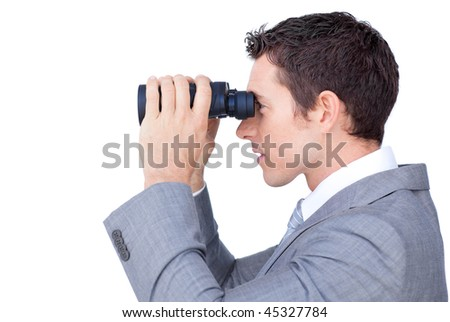 Visionary businessman looking through binoculars against a white background