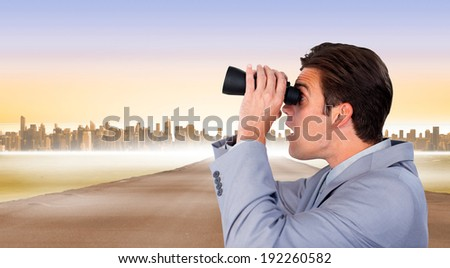 Visionary businessman looking to the future against cityscape on the horizon - stock photo