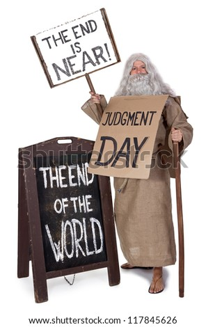 Visionary with a sign of the end of the world isolated on white background. The bearded monk carries a board The end is Near. Senior prophet shows up a sign with a text of Armageddon.