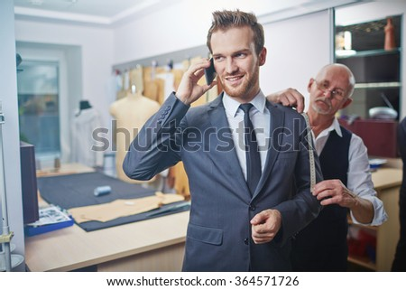 Visiting tailor - stock photo