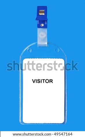 Visitor name badge ID isolated on blue background - stock photo