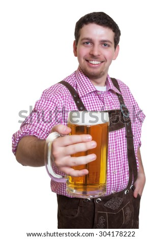 Visitor of the bavarian Oktoberfest with a glass of beer - stock photo