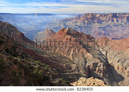 Vista of the Grand Canyon from Desert View Overlook. Smoke from fires on the North Rim can be seen in the distance, generating a haze over the Canyon. - stock photo