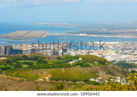 Vista overlooking Honolulu's National Cemetery of the Pacific (Punchbowl) with harbor and airport behind - stock photo