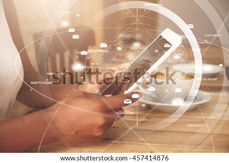 Visual effects. Double exposure. African woman sitting at a restaurant, waiting for her boyfriend, holding contemporary white touchpad with blank screen for your advertising content in her hands - stock photo