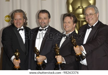 Visual Effects winners JIM RYGIEL (left), JOE LETTERI, RANDALL WILLIAM COOK & ALEX FUNKE at the 75th Annual Academy Awards at the Kodak Theatre, Hollywood. March 23, 2003
