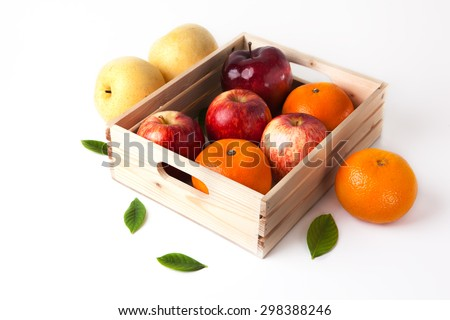 vitamin c fruit in wooden box - stock photo
