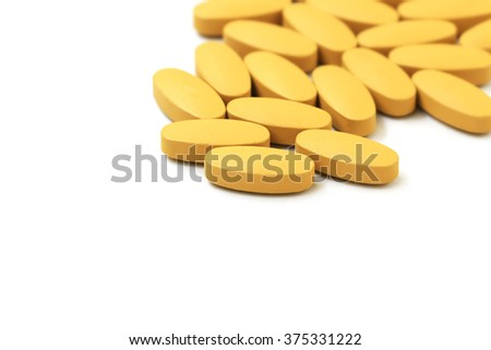 Vitamin C pills on white background