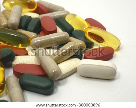 Vitamin, drug,multivitamin, herbal supplement capsules, fish oil,Natural organic green algae tablets Colorful drugs,pills and tablets, background, isolated on white background - stock photo