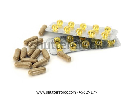 Vitamin E and herbal pills. Isolated on white background. - stock photo