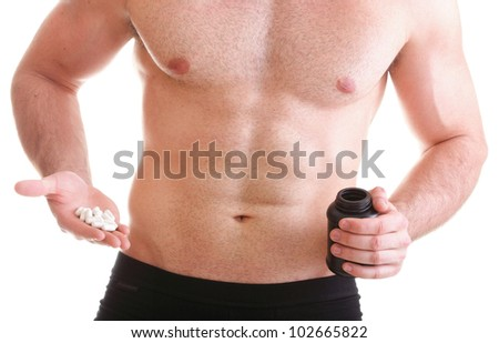 vitamin or pill drag tablet Man isolated offering pill in one and pills in bottle - in another hand. Copy space boxes with supplements - stock photo