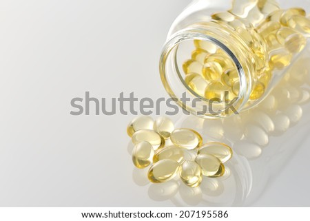Vitamnin D Capsule with bottle - stock photo
