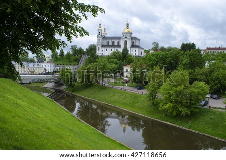 Vitebsk, Belarus - May 25, 2016:church, green grass and the river in the city