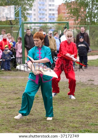 VITEBSK, BELARUS - May 16: Performance of group of oriental combat sports on sports holiday May, 16, 2009 in Vitebsk, Belarus - stock photo