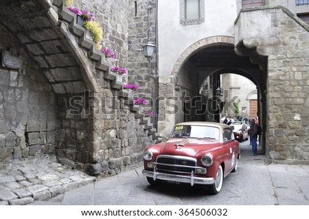 VITERBO (VT), ITALY - MAY 16: A red Fiat 1900 A Berlina takes part to the 1000 Miglia classic car race on May 16, 2015 in Viterbo (VT). The car was built in 1954. - stock photo