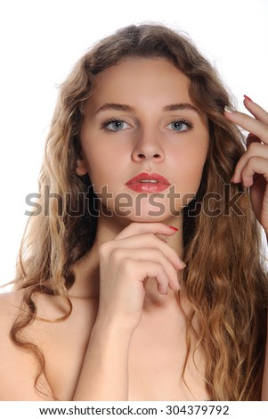 Vivid closeup portrait of a beautiful girl with perfect clean skin isolated on white - stock photo