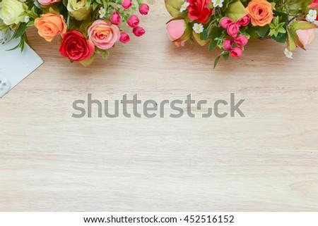 Vivid color effect.Blurry Flowers bouquet shoot soft focus arrange for decoration on wood background.With copy space. - stock photo