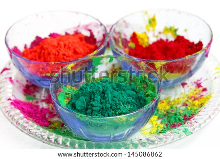 Vivid color gulal kept in a bowl focus on green - stock photo