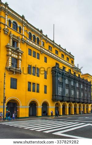 Vivid colored buildings at the Plaza de Armas, Lima. - stock photo