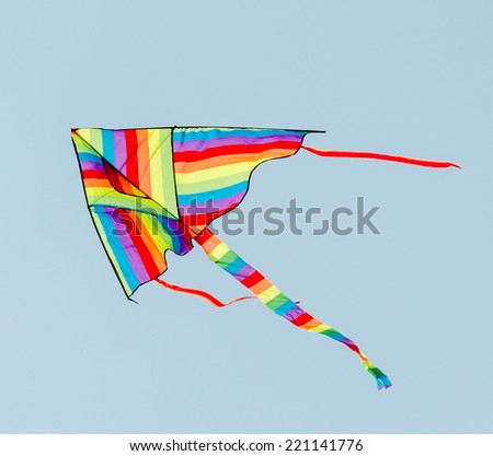 Vivid colored kite in the blue sky, close up
