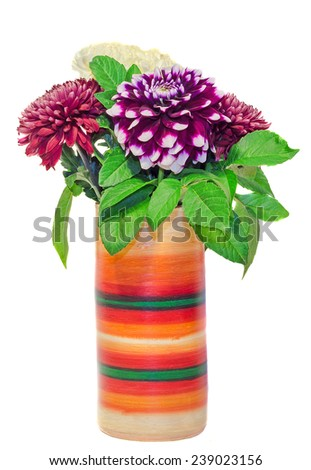 Vivid colored vase with chrysanthemum and dhalia purple flowers, isolated, white background - stock photo