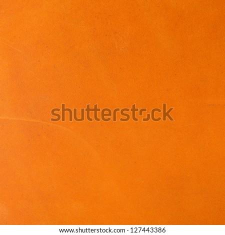 Vivid orange leather background - stock photo
