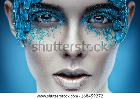vivid portrait of a girl with an unusual blue make-up - stock photo