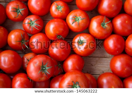 Vivid Red Fresh Tomatoes for Sale at Outdoor Farmers Market - stock photo
