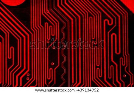 vivid red pcb board integrated circuit motherboard computer parts abstract background - stock photo