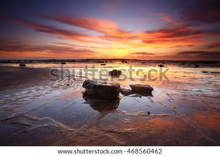Vivid sunrise and reflections across Long Reef in Sydney's Northern beaches, Australia