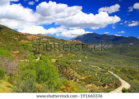 Vivid vegetation surrounding the mountain town of Arachova near Parnassus Mountains, Greece - stock photo