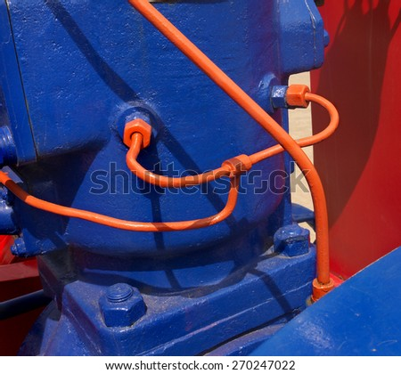 vividly, bright colored unusual vintage hydraulic aggregate - stock photo