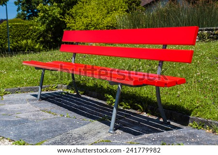Vividly red empty bench