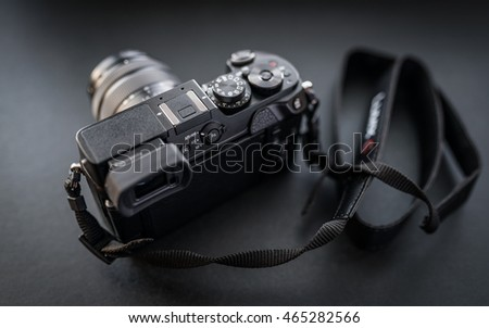 VLADIVOSTOK, RUSSIA - JULY 15, 2016: Studio shot of camera Panasonic GX8 on a dark background. The camera features a newly developed 20 megapixel sensor