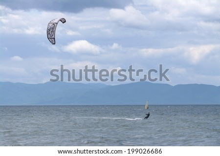 VLADIVOSTOK, RUSSIA - JUNE 14: An unidentified kite-boarder in the sea before the storm, June 14 2014, Sea of Japan, Amursky Bay, Vladivostok, Russia.