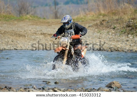 "Vladivostok, Russia - may 1, 2014: cars, motorcycles, Enduro and ATV, go off-roading in five-day race ""Russian rally 2014"""