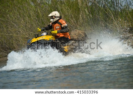 "Vladivostok, Russia - may 1, 2014: cars, motorcycles, Enduro and brp ATV, go off-roading in five-day race ""Russian rally 2014"""