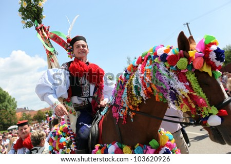 VLCNOV, CZECH REPUBLIC, MAY 27: Horseman from king's company during celebration Ride of kings on May 27, 2012, Vlcnov, Czech rep. Celebration is on UNESCO list of Intangible Cultural Heritage. - stock photo