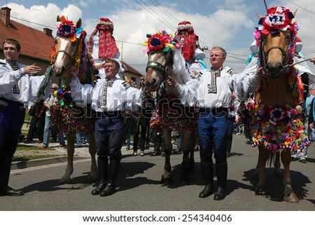 VLCNOV, CZECH REPUBLIC - MAY 26, 2013: Young boy Ondrej Franta elected to play the King rides a decorated horse during the Ride of the Kings folklore festival in Vlcnov, South Moravia, Czech Republic.