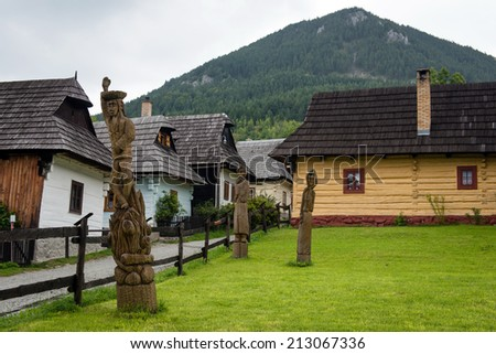 Vlkolinec - picturesque historical village with traditional houses and wooden statues, Slovakia - UNESCO World Heritage site - stock photo