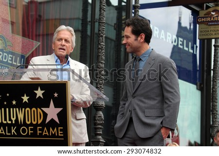 vLOS ANGELES - JUL 1:  Michael Douglas, Paul Rudd at the Paul Rudd Hollywood Walk of Fame Star Ceremony at the El Capitan Theater Sidewalk on July 1, 2015 in Los Angeles, CA - stock photo