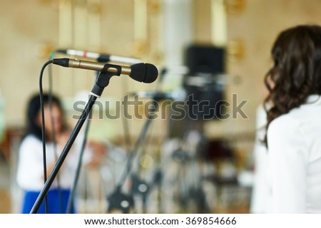 Vocal Dynamic Microphone on the stage at Conference - stock photo