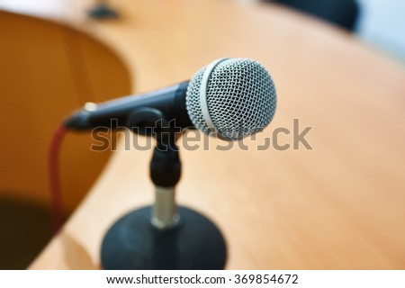 Vocal Dynamic Microphone on the table at Conference