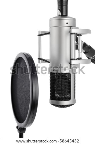 Vocal recording setup containing a professional microphone and pop filter on white background - stock photo