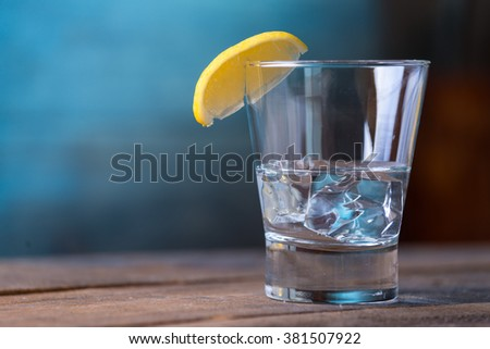 Vodka drinks with lemon and lime garnish